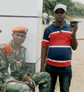 John Ndagano (right) with Samuel, one of his disciples at the military camp where he ministers.
